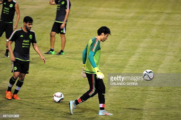 Mexican player Carlos Vela and goalkeeper Guillermo Ochoa take part in a field recognition at the Olimpico Metropolitano stadium in San Pedro Sula...