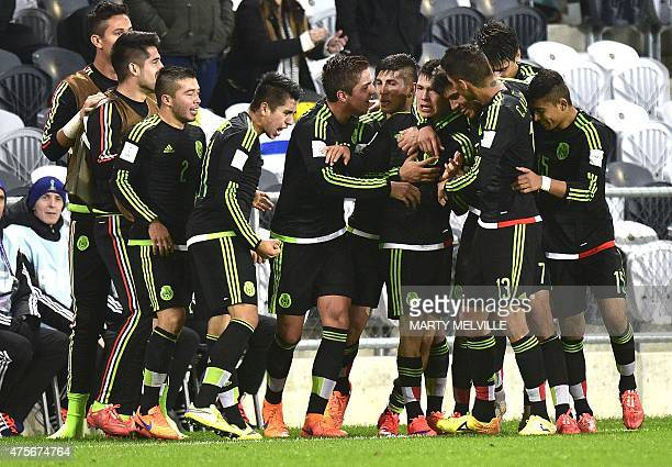 Mexican players celebrate a goal during the FIFA Under20 World Cup football match between Mexico and Uruguay at Otago Regional Stadium in Dunedin on...