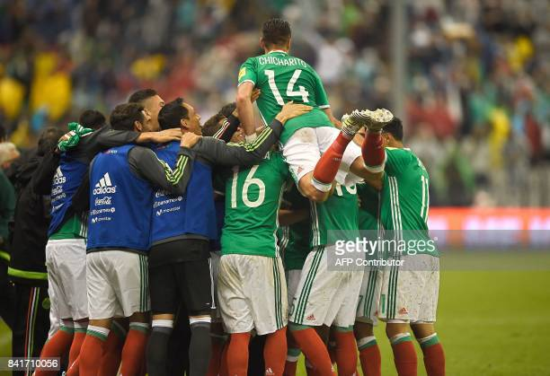Mexican players celebrate after scoring against Panama during their FIFA World Cup 2018 CONCACAF qualifiers football match in Mexico City on...