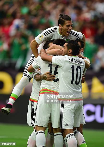 Mexican players celebrate after scoring against Uruguay during their Copa America Centenario football tournament in Glendale Arizona United States on...