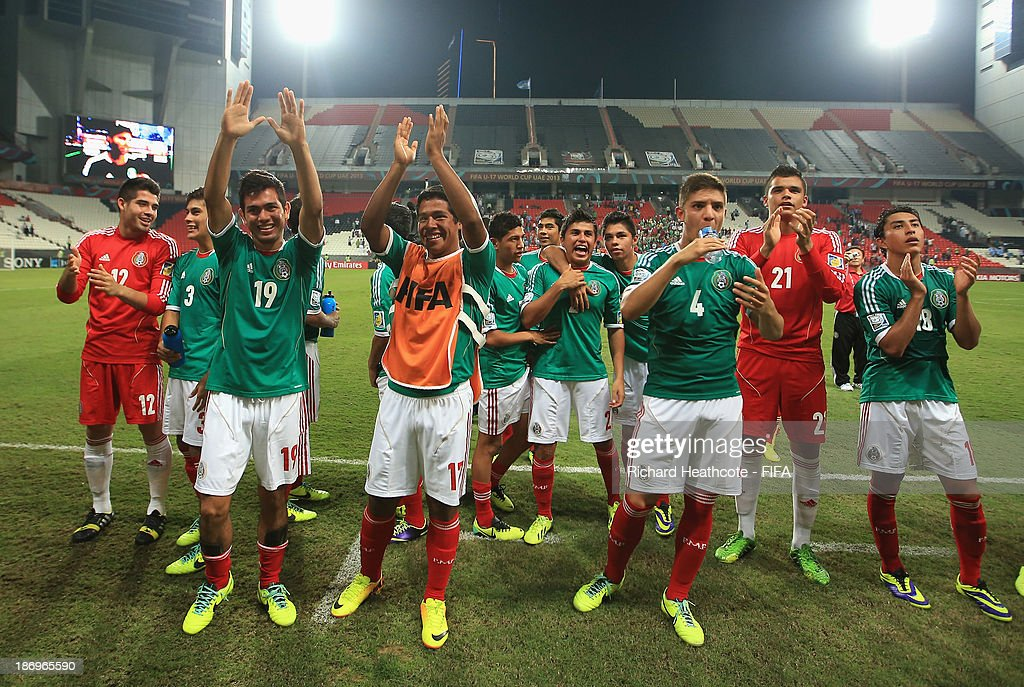 Mexican players celebrate at the final whistle during the FIFA U-17 World Cup UAE 2013 Semi Final match between Argentina and Mexico at the Mohamed Bin Zayed Stadium on November 5, 2013 in Abu Dhabi, United Arab Emirates.