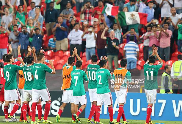 Mexican players celebrate with their fans after beating Argentina 30 during the two teams' semifinal of the FIFA U17 World Cup at the Mohammad Bin...