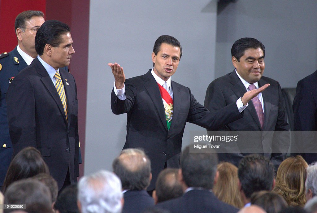 Mexican president Enrique Peña Nieto gestures during the Presentation of Second Anual Report of Mexican Federal Government at National Palace on September 02, 2014 in Mexico City, Mexico.