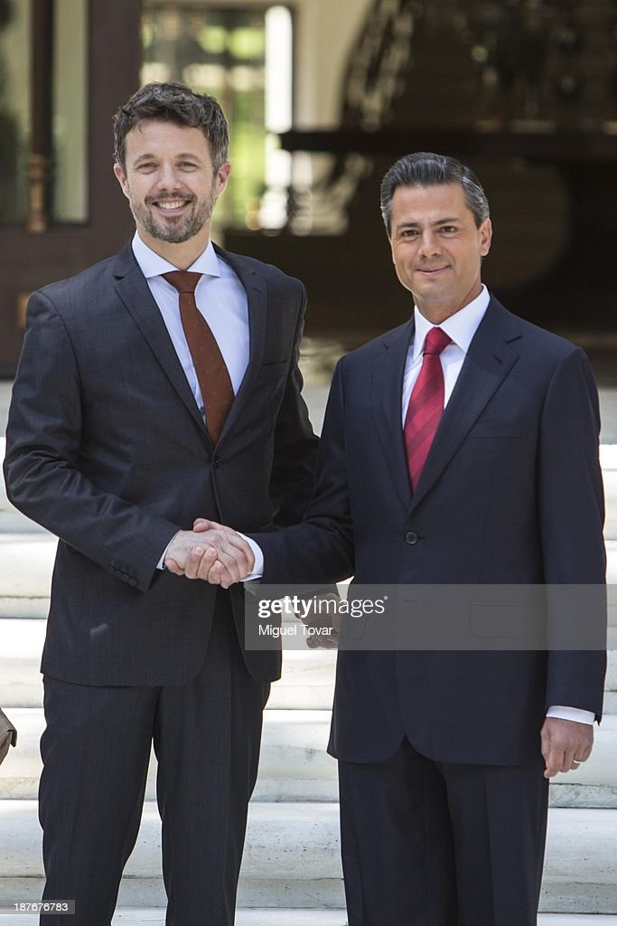 Mexican President Enrique Pe–ña Nieto shakes hands with Frederik André Henrik Christian de Glücksburg crown prince of Denmark, during the welcome ceremony at Los Pinos official recidence on November 11, 2013 in Mexico City, Mexico.