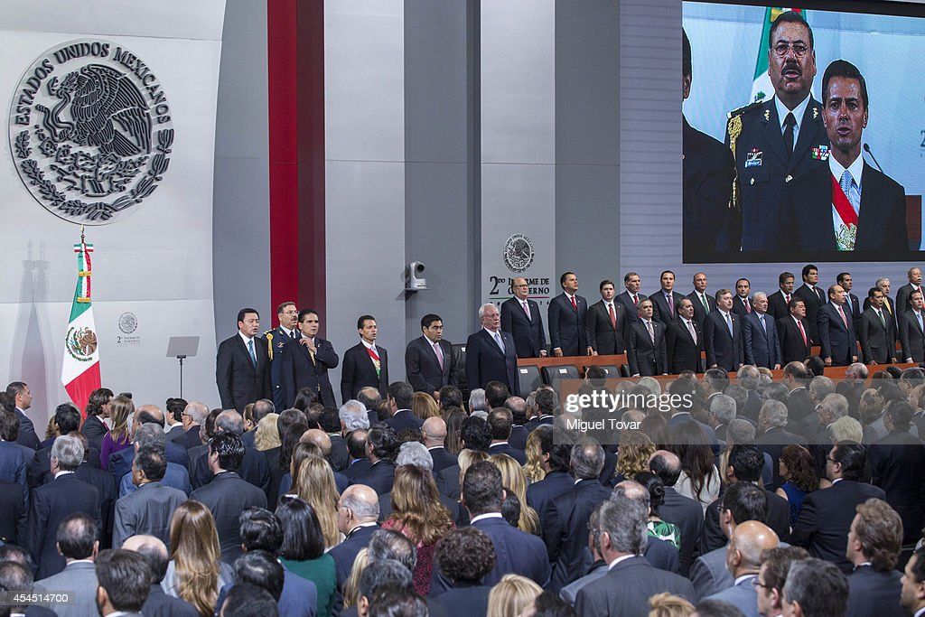 Mexican president Enrique Peñ–a Nieto sings the national anthem during the Presentation of Second Annual Report of Mexican Federal Government at National Palace on September 02, 2014 in Mexico City, Mexico.