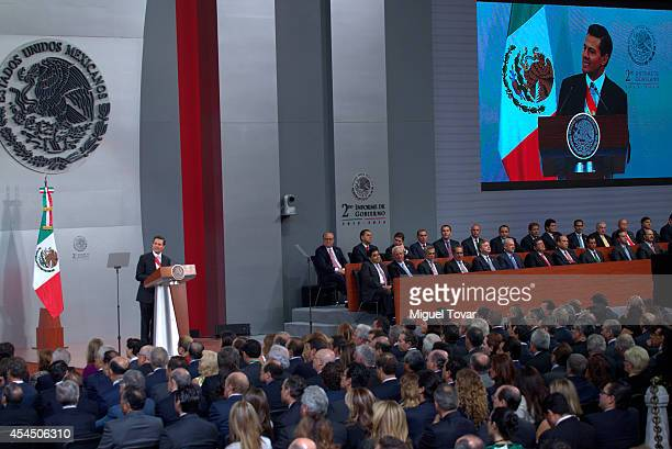 Mexican president Enrique Peña Nieto speaks during the Presentation Of Second Annual Report of Mexican Federal Government at National Palace on...
