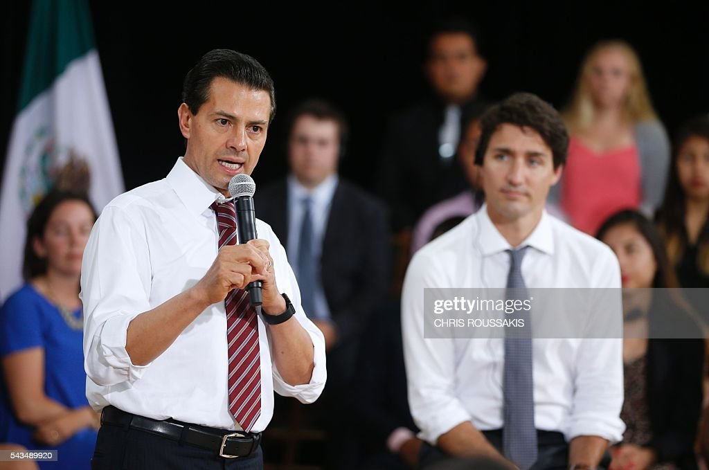 Mexican President Enrique Pena Nieto (left) and Canadian Prime Minister Justin Trudeau (right) take part in a youth question and answer session ahead of the 'Three Amigos Summit' in Ottawa, June 28, 2016. Canadian Prime Minister Justin Trudeau and his guests US President Barack Obama and Mexican President Enrique Pena Nieto will meet in Ottawa for the North American Leaders Summit June 29 morning under a climate of economic uncertainty following Britain's vote to leave the European Union. / AFP / Chris Roussakis