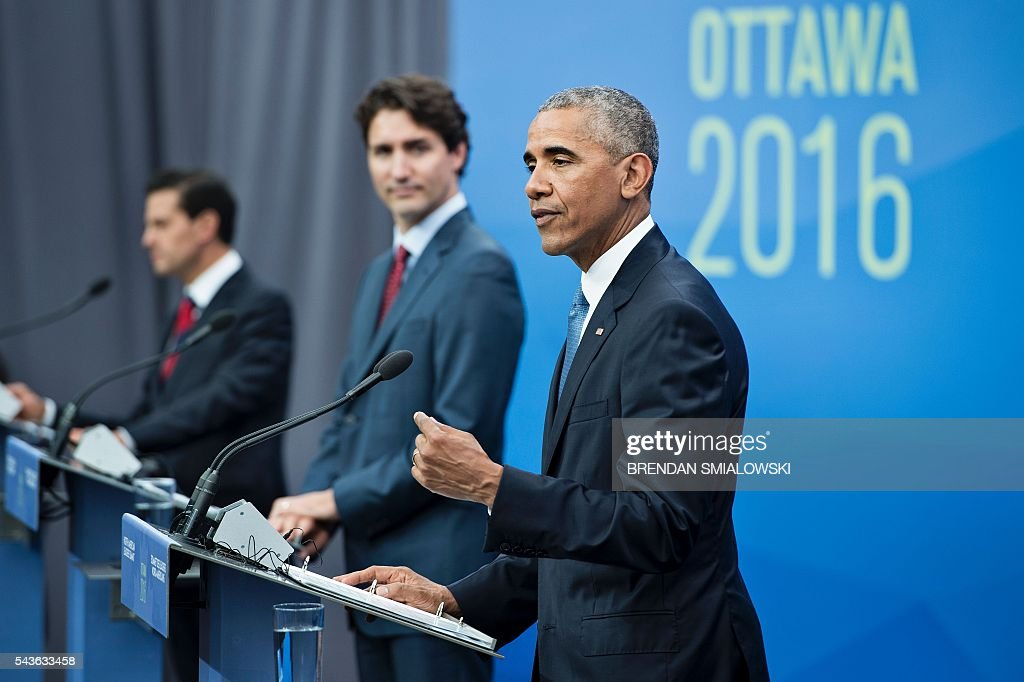 Mexican President Enrique Pena Nieto, and Canadian Prime Minister Justin Trudeau look on as US President Barack Obama speaks during a trilateral press conference at the North American Leaders Summit at the National Gallery of Canada June 29, 2016 in Ottawa, Ontario. / AFP / Brendan Smialowski