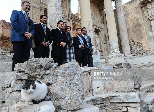 Mexican President Enrique Pena Nieto and his spouse Angelica Rivare Hurtado de Pena visit the ancient city of Ephesus on December 19 2013 in Izmir...