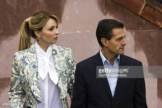 Mexican President Enrique Pena Nieto and his wife Angelica Rivera arrive at the colonial Museum of Guadalupe in Guadalupe Zacatecas Mexico on July 1...