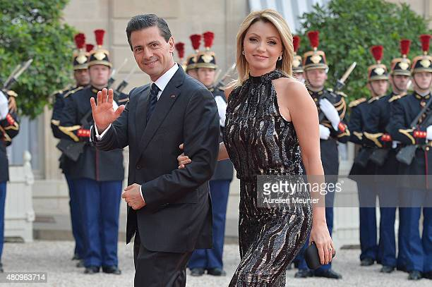 Mexican President Enrique Pena Nieto and his wife Angelica Rivera arrive to a State Diner given in their honor by French President Francois Hollande...