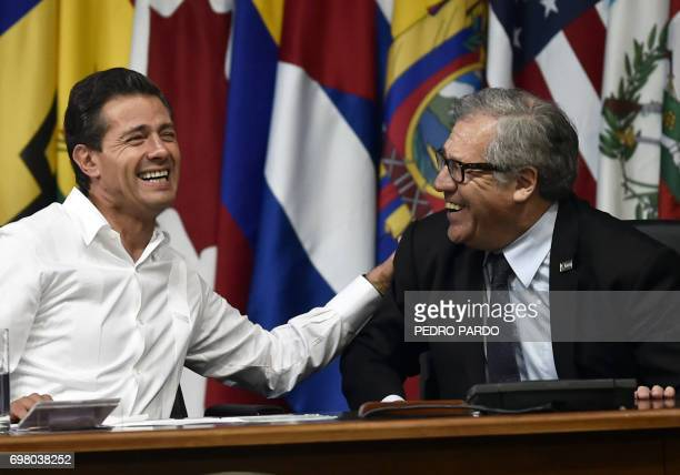 Mexican President Enrique Pena Nieto and Organization of American States Secretary General Luis Almagro laugh during the opening ceremony of the OAS...