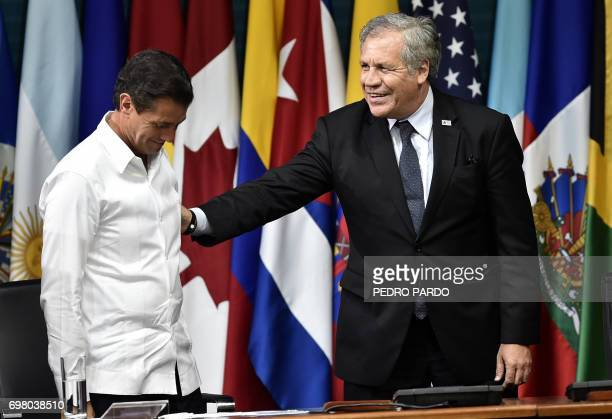 Mexican President Enrique Pena Nieto and Organization of American States Secretary General Luis Almagro greet each other during the opening ceremony...
