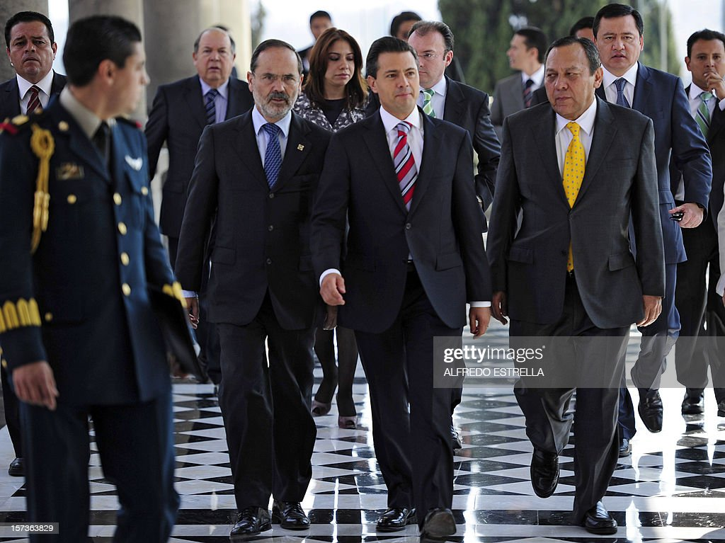 Mexican President Enrique Pena Nieto (C), arrives with the President of the Democratic Revolution Party (PRD), Jesus Zambrano (R), the President of the National Action Party (PAN), Gustavo Madero (2-L), to sign the 'Pact for Mexico', on December 2, 2012 in Mexico City. Pena Nieto and the main three polical parties of Mexico, signed Sunday an agreement to launch reforms to strengthen democracy, fight social inequality and promote economical growth. AFP PHOTO/Alfredo Estrella