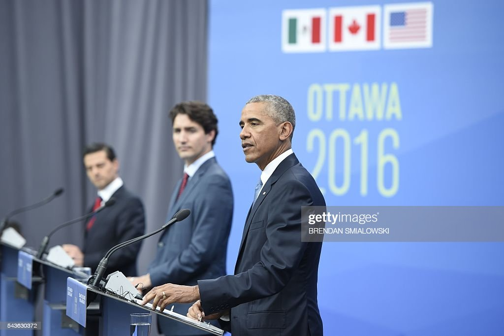 Mexican President Enrique Pena Nieto, Canadian Prime Minister Justin Trudeau and US President Barack Obama attend a press conference at the North American Leaders Summit at the National Gallery of Canada June 29, 2016 in Ottawa, Ontario. / AFP / Brendan Smialowski