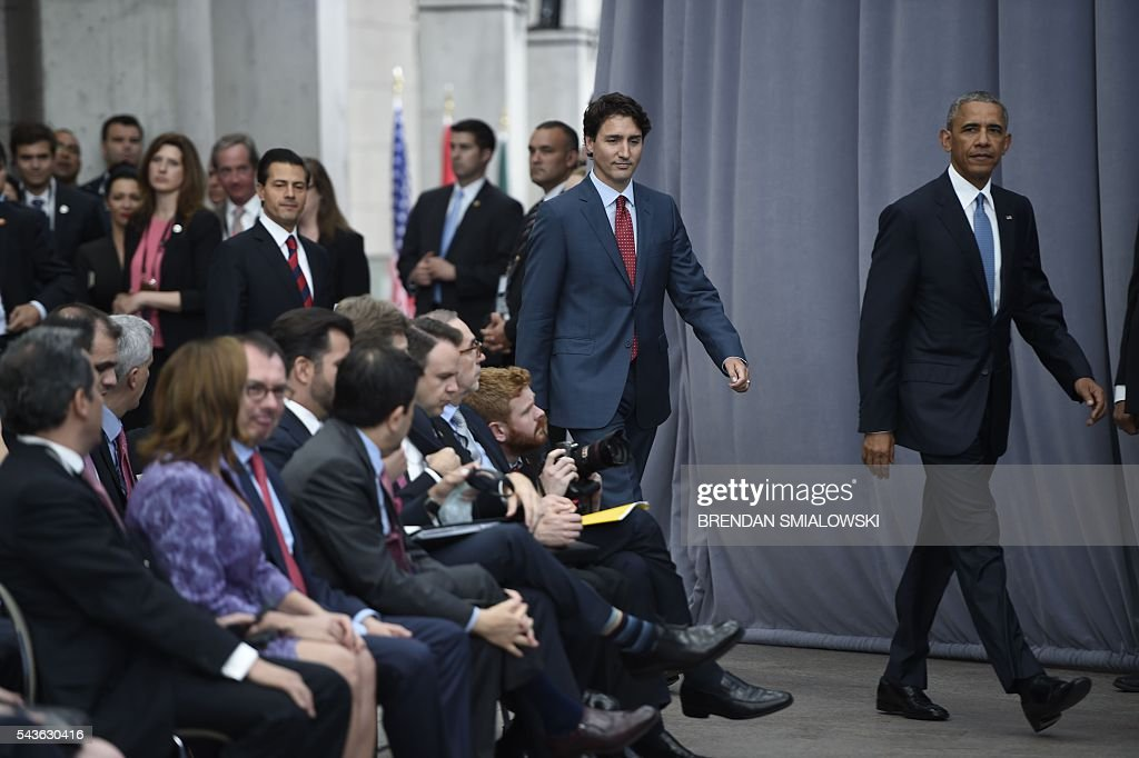 Mexican President Enrique Pena Nieto, Canadian Prime Minister Justin Trudeau and US President Barack Obama arrive for a press conference at the North American Leaders Summit at the National Gallery of Canada June 29, 2016 in Ottawa, Ontario. / AFP / Brendan Smialowski