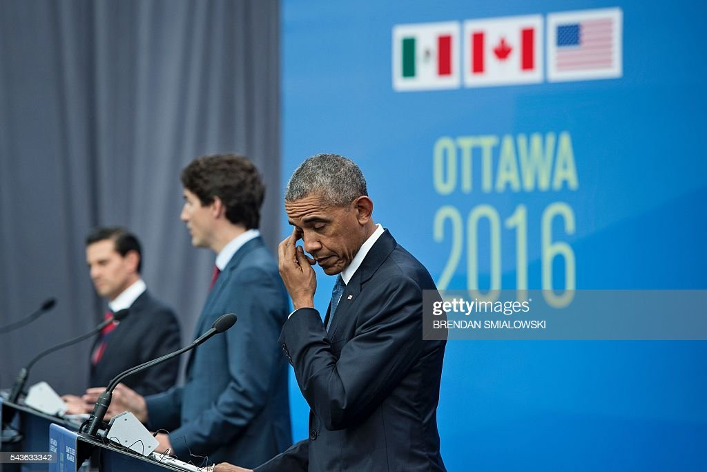 Mexican President Enrique Pena Nieto, Canadian Prime Minister Justin Trudeau and US President Barack Obama listen to questions during a trilateral press conference at the North American Leaders Summit at the National Gallery of Canada June 29, 2016 in Ottawa, Ontario. / AFP / Brendan Smialowski