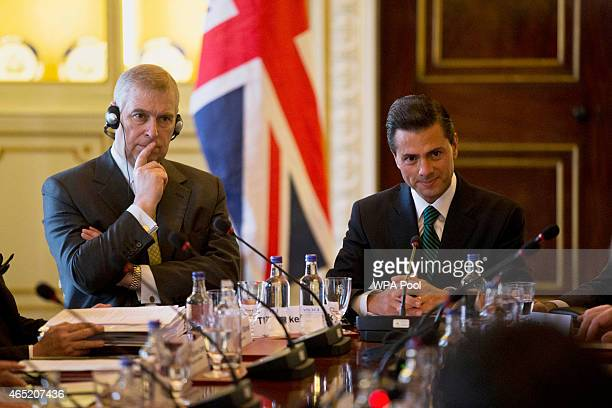 Mexican President Enrique Pena Nieto center sits at the top of the table right with Britain's Prince Andrew Duke of York left during a business...