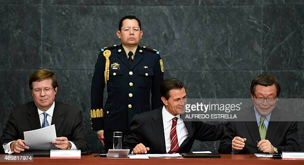 Mexican President Enrique Pena Nieto chats with the Executive Chairman Executive of Toyota Motor Sales Yoshimi Inaba next to the Chief Executive...