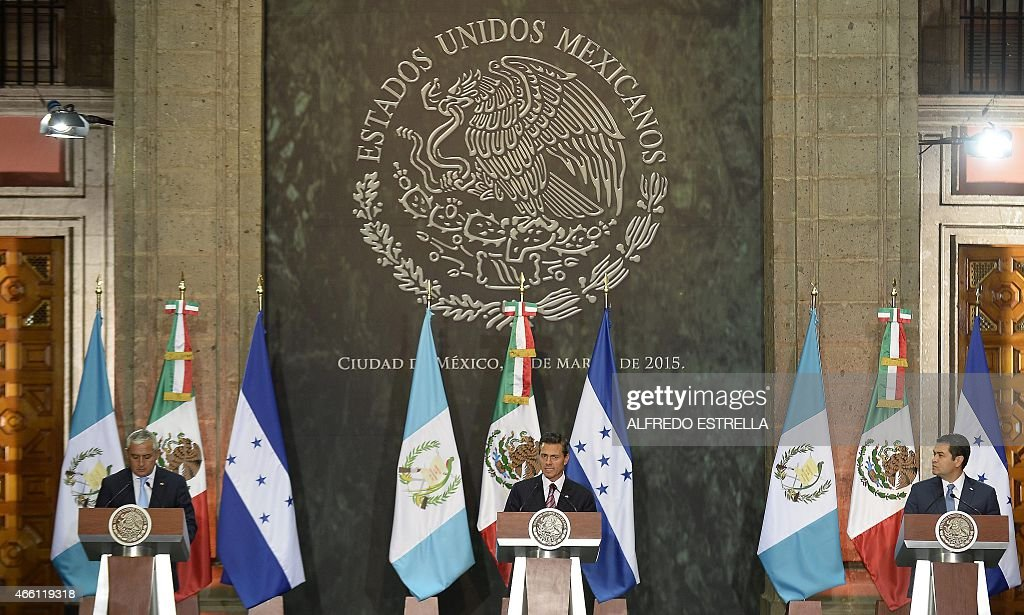Mexican President Enrique Pena Nieto delivers a speech after holding a meeting with Guatemalan President Otto Perez Molina and Honduras Juan Orlando...