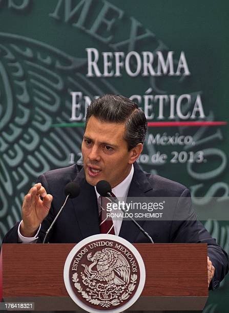 Mexican President Enrique Pena Nieto delivers a speech before the signing of the bill of constitutional reform that allows stateowned oil company...
