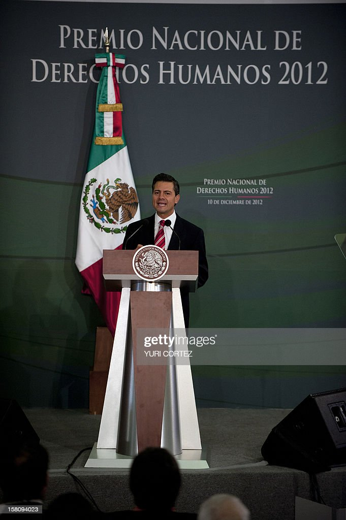 Mexican President, Enrique Pena Nieto, delivers a speech during a ceremony in which he decorated Mexican Catholic priest Alejandro Solalinde (out of frame) with the National Human Rights Award at Los Pinos Presidential Palace in Mexico City on December 10, 2012. Solalinde is the founder and director of 'Brothers on the Road' shelter in Oaxaca, Mexico, which dedicates to defend the rights of migrants, receiving some 200 per day. AFP PHOTO/ YURI CORTEZ