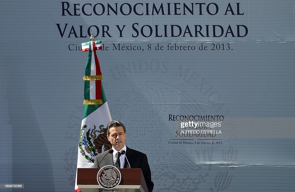 Mexican President Enrique Pena Nieto delivers a speech during a tribute to the victims of the explosion that rocked the headquarters of Mexico's state-owned oil firm Pemex last month, killing 37 people, in Mexico City on February 8, 2013. The explosion, caused by an accumulation of gas, tore through a human resources building next to the company's skyscraper on January 31, destroying lower floors, causing thousands of workers to flee into the street and injuring more than 120 people -- besides the 37 mortal victims. AFP PHOTO/YURI CORTEZ