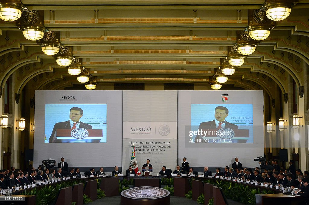 Mexican President Enrique Pena Nieto (C) delivers a speech during the II Session of the National Public Security Council, at the National Palace in Mexico City, on December 17, 2012. AFP PHOTO/Alfredo ESTRELLA