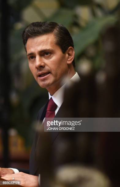 Mexican President Enrique Pena Nieto delivers a speech during the 'Peace Rose' ceremony at the Palace of Culture in downtown Guatelama City on June 6...