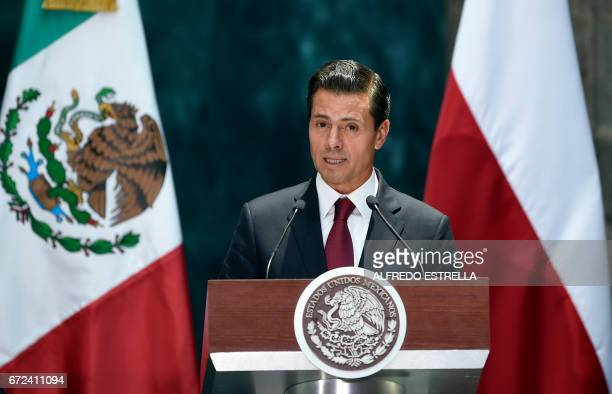 Mexican President Enrique Pena Nieto gives a message to the media along with his Polish counterpart Andrzej Duda at the National Palace in Mexico...