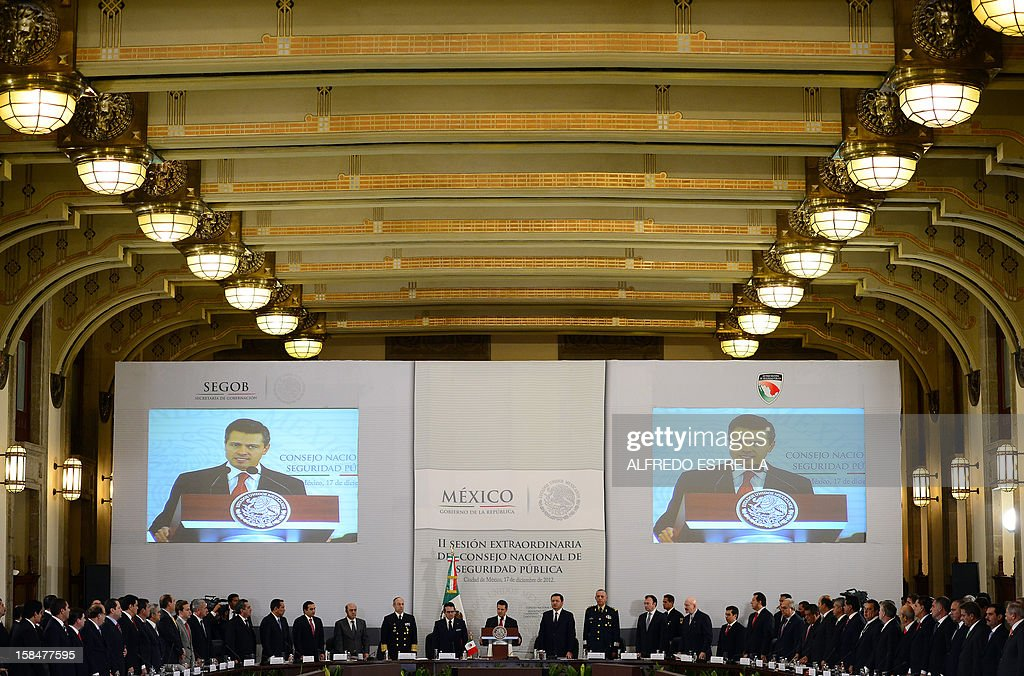 Mexican President Enrique Pena Nieto (C), in the presence of the country's 31 governors and others authorities, delivers a speech during the II Session of the National Public Security Council, at the National Palace in Mexico City, on December 17, 2012. AFP PHOTO/Alfredo ESTRELLA
