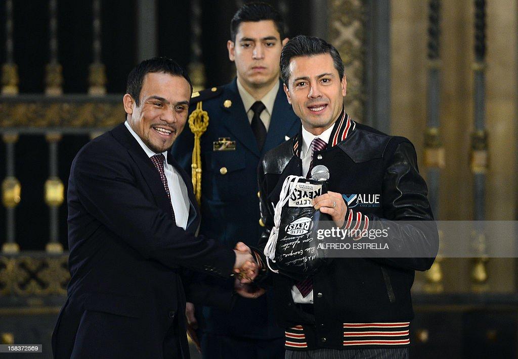Mexican President Enrique Pena Nieto (R) poses with Mexican boxer Juan Manuel Marquez (L), welterweight champion, at the Palacio Nacional, in Mexico City, on December 14, 2012. AFP PHOTO/Alfredo Estrella