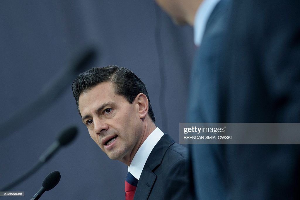 Mexican President Enrique Pena Nieto speaks during a press conference at the North American Leaders Summit at the National Gallery of Canada June 29, 2016 in Ottawa, Ontario. / AFP / Brendan Smialowski