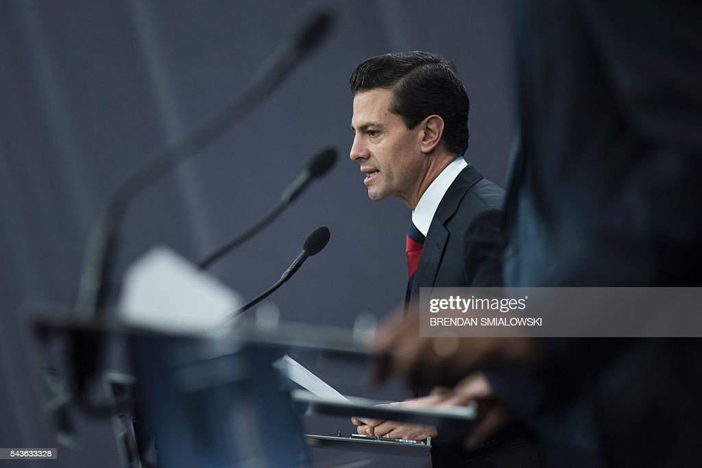 Mexican President Enrique Pena Nieto speaks during a trilateral press conference with Canadian Prime Minister Justin Trudeau and US President Barack Obama at the North American Leaders Summit at the National Gallery of Canada June 29, 2016 in Ottawa, Ontario. / AFP / Brendan Smialowski