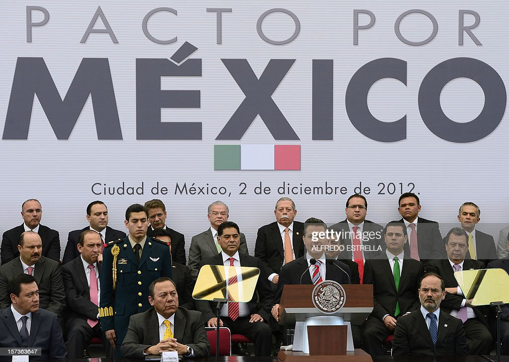 Mexican President Enrique Pena Nieto (2-L, bottom row) speaks next to Mexican Interior Minister, Miguel Osorio Chong (L, bottom row), the President of the Democratic Revolution Party (PRD), Jesus Zambrano (2-L, bottom row), and the President of the National Action Party (PAN), Gustavo Madero (R, bottom row), as they make the 'Pact for Mexico', on December 2, 2012 in Mexico City. Pena Nieto and the main three polical parties of Mexico, signed Sunday an agreement to launch reforms to strengthen democracy, fight social inequality and promote economical growth. AFP PHOTO/Alfredo Estrella