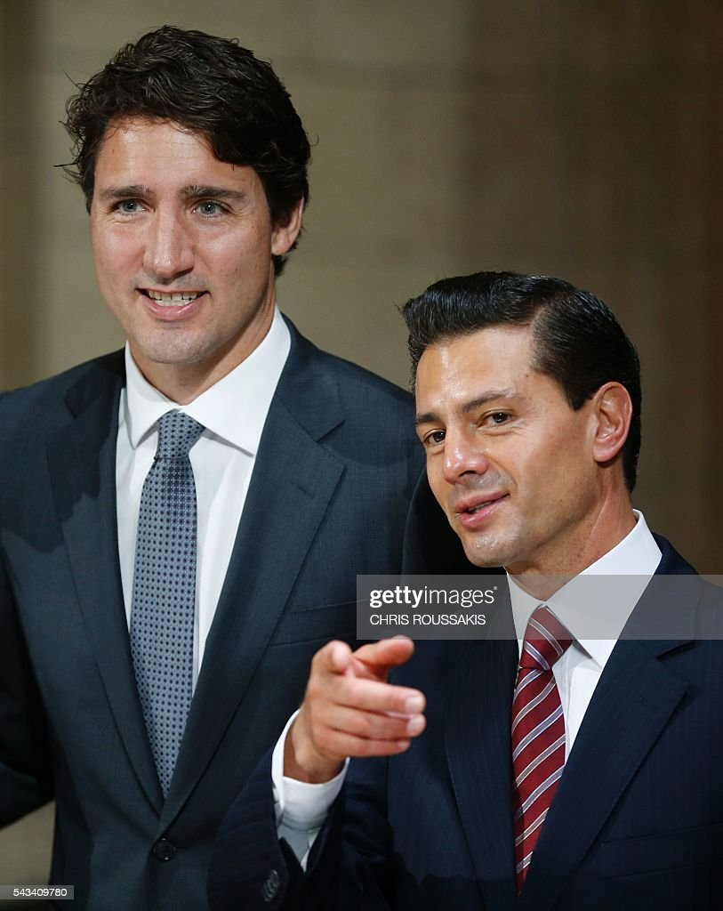 Mexican President Enrique Pena Nieto(R)and Canadian Prime Minister Justin Trudeau(L)take part in bilateral meetings ahead of the 'Three Amigos Summit' in Ottawa, Canada June 28, 2016. Canadian Prime Minister Justin Trudeau and his guests US President Barack Obama and Mexican President Enrique Pena Nieto will meet in Ottawa for the North American Leaders Summit June 29 morning under a climate of economic uncertainty following Britain's vote to leave the European Union. / AFP / Chris Roussakis