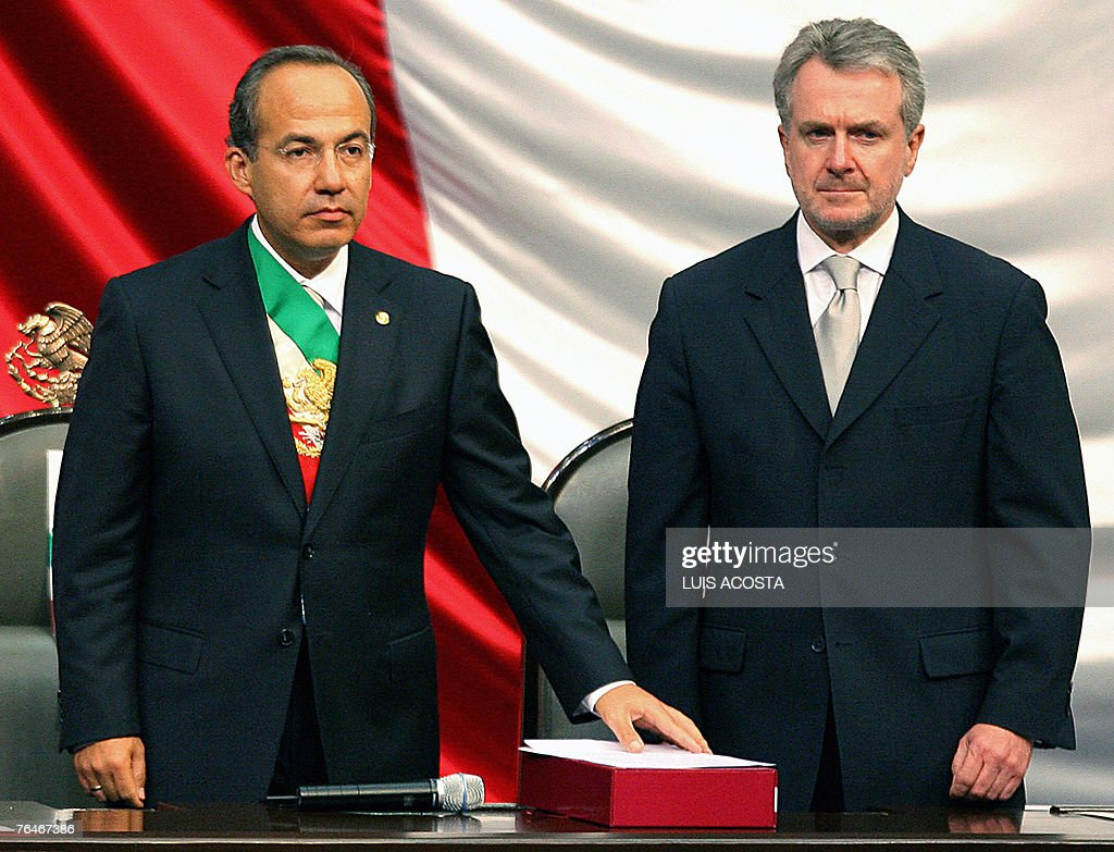 Mexican President Felipe Calderon stands next to PAN's senator Santiago Creel before handing over his government's first report 01 September 2007 at...