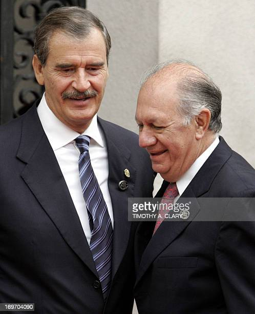 Mexican President Vicente Fox is greeted by Chilean President Ricardo Lagos as he arrives at the La Moneda Palacein Santiago Chile 21 November 2004...