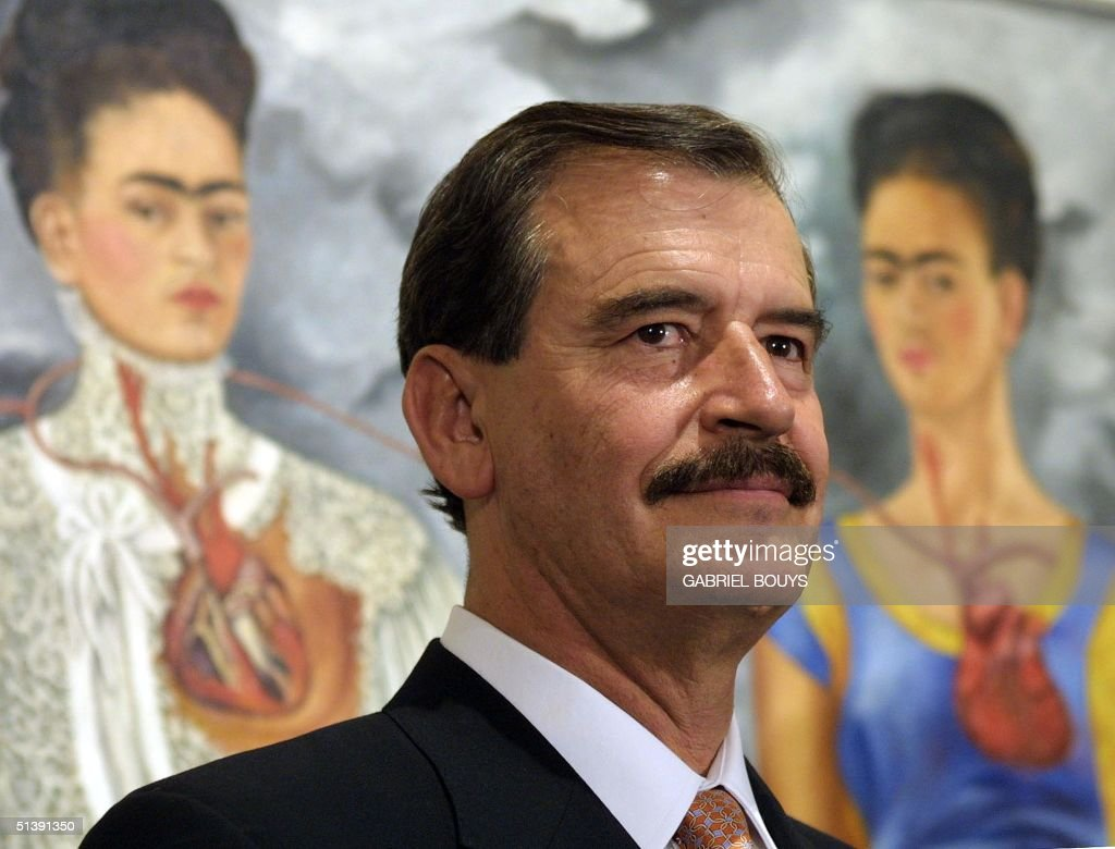Mexican President <a gi-track='captionPersonalityLinkClicked' href=/galleries/search?phrase=Vicente+Fox&family=editorial&specificpeople=202615 ng-click='$event.stopPropagation()'>Vicente Fox</a> Quesada inaugurates the exhibition of Mexican painter Frida Kahlo at Rome's National gallery of modern Art, 17 October 2001. The painting behind President <a gi-track='captionPersonalityLinkClicked' href=/galleries/search?phrase=Vicente+Fox&family=editorial&specificpeople=202615 ng-click='$event.stopPropagation()'>Vicente Fox</a> is entitled 'The two Frida'. The Mexican President is in Italy on a two-day visit. AFP PHOTO GABRIEL BOUYS