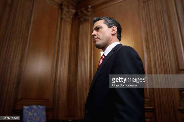 Mexican PresidentElect Enrique Pena Nieto arrives for a photo opportunity after meeting with Democratic members of the House in the Rayburn Room at...