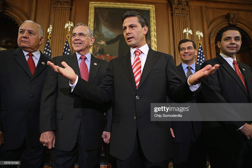 Mexican President-Elect Enrique Pena Nieto (C) briefly answers a reporter's question with members of Congress (L-R) Rep. Silvestre Reyes (D-TX), Rep. Ruben Hinojosa (D-TX) Rep. Xavier Becerra (D-CA) and Rep. Henry Cuellar (D-TX) in the Rayburn Room at the U.S. Capitol November 27, 2012 in Washington, DC. Nieto, of Mexico's Institutional Revolutionary Party, will also visit the White House and meet with President Barack Obama today, days before he takes office on December 1.