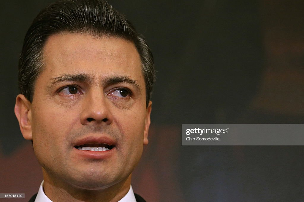 Mexican President-Elect Enrique Pena Nieto delivers brief remarks after meeting with Democratic members of the House in the Rayburn Room at the U.S. Capitol November 27, 2012 in Washington, DC. Nieto, of Mexico's Institutional Revolutionary Party, will also visit the White House and meet with President Barack Obama today, days before he takes office on December 1.