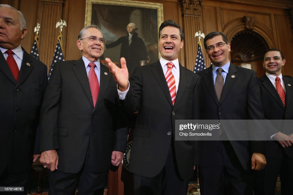 Mexican President-Elect Enrique Pena Nieto (C) shares a laugh with members of Congress (L-R) Rep. Silvestre Reyes (D-TX), Rep. Ruben Hinojosa (D-TX), Rep. <a gi-track='captionPersonalityLinkClicked' href=/galleries/search?phrase=Xavier+Becerra&family=editorial&specificpeople=2369133 ng-click='$event.stopPropagation()'>Xavier Becerra</a> (D-CA) and Rep. Henry Cuellar (D-TX) pose for photos in the Rayburn Room at the U.S. Capitol November 27, 2012 in Washington, DC. Nieto, of Mexico's Institutional Revolutionary Party, will also visit the White House and meet with President Barack Obama today, days before he takes office on December 1.