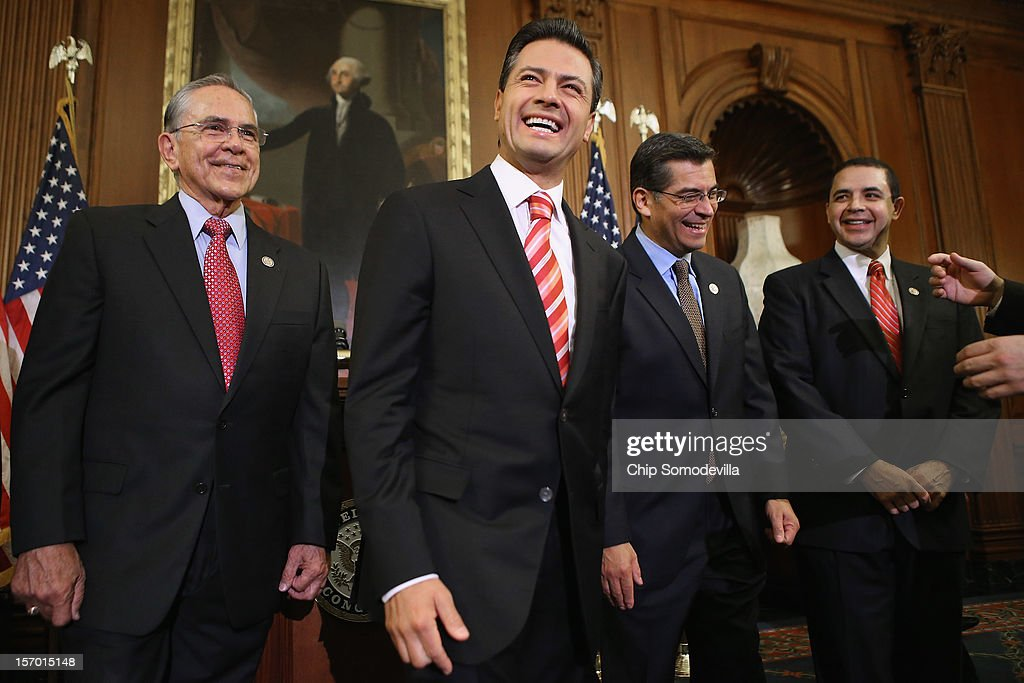 Mexican President-Elect Enrique Pena Nieto (2L) shares a laugh with members of Congress (L-R) Rep. Ruben Hinojosa (D-TX), Rep. Xavier Becerra (D-CA) and Rep. Henry Cuellar (D-TX) in the Rayburn Room at the U.S. Capitol November 27, 2012 in Washington, DC. Nieto, of Mexico's Institutional Revolutionary Party, will also visit the White House and meet with President Barack Obama today, days before he takes office on December 1.