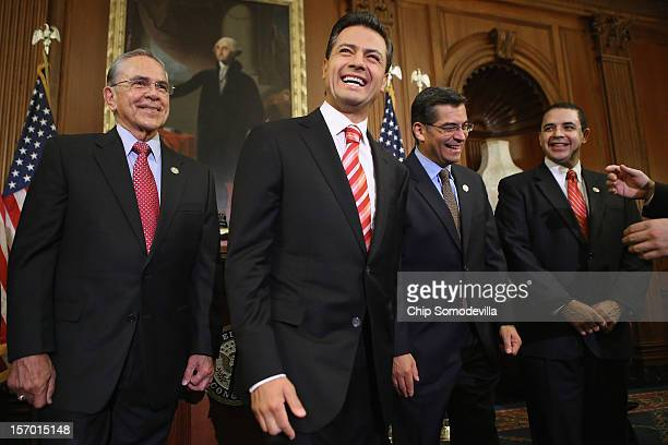 Mexican PresidentElect Enrique Pena Nieto shares a laugh with members of Congress Rep Ruben Hinojosa Rep Xavier Becerra and Rep Henry Cuellar in the...