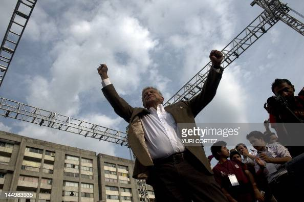 Mexican presidential candidate for the leftist coalition Progressive Movement of Mexico Andres Manuel Lopez Obrador raises his arms during an...