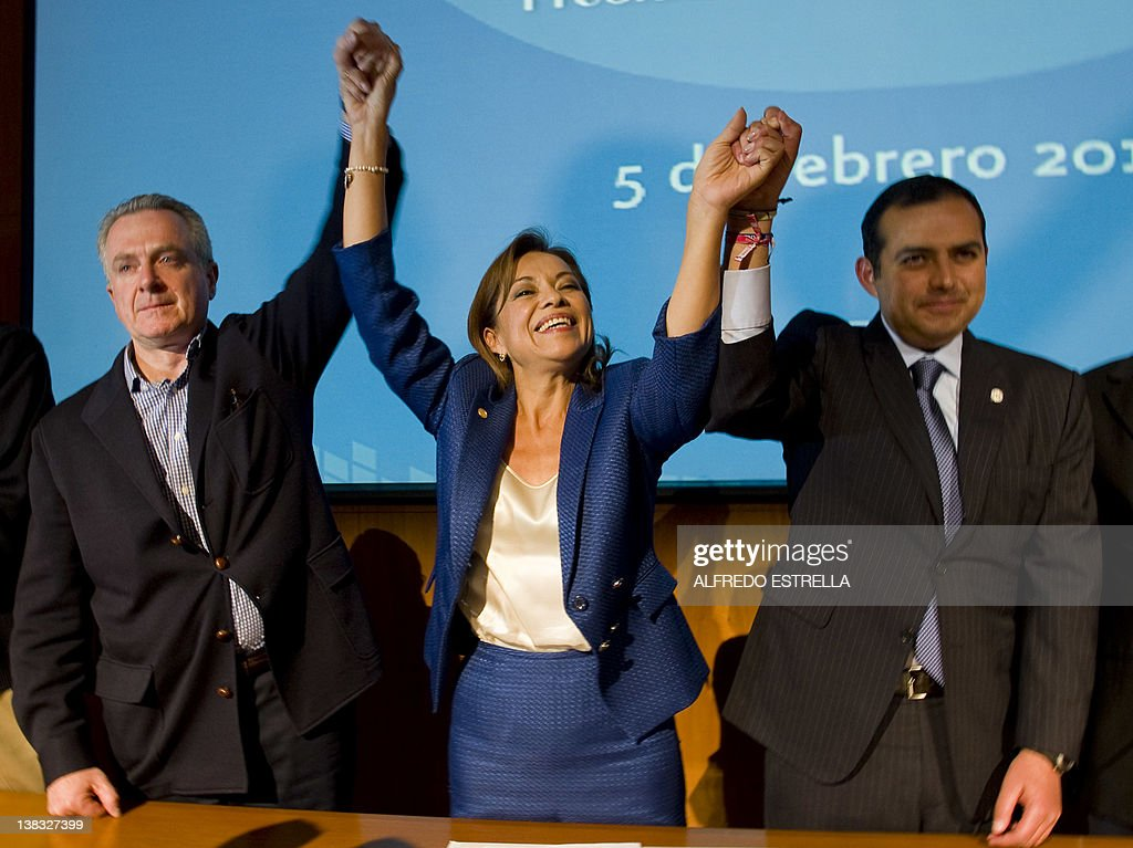 Mexican presidential candidate Josefina Vazquez Mota celebrates her victory with her counterparts Santiago Creel and Ernesto Cordero from National...