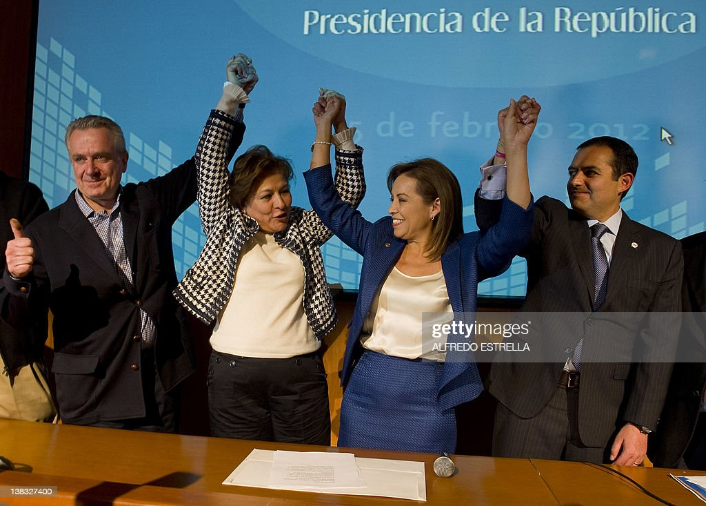 Mexican presidential candidate Josefina Vazquez Mota celebrates her victory with her counterparts Santiago Creel and Ernesto Cordero and candidate of...