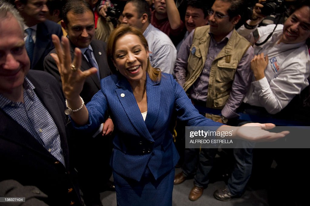 Mexican presidential candidate Josefina Vazquez Mota celebrates her victory with her counterpart Santiago Creel from the National Action Party during...