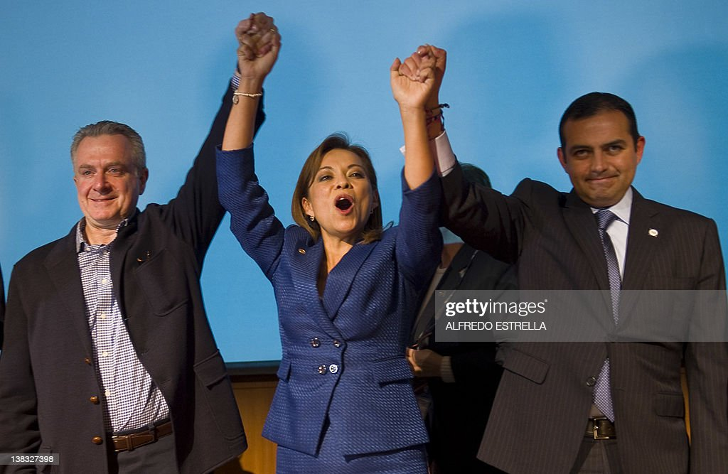 Mexican presidential candidate Josefina Vazquez Mota celebrates with her counterparts Santiago Creel and Ernesto Cordero from National Action Party...